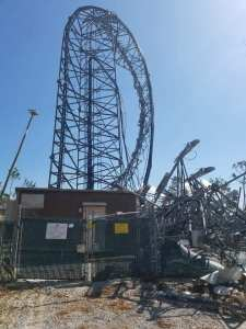 Cell phone tower mangled by hurricane winds.