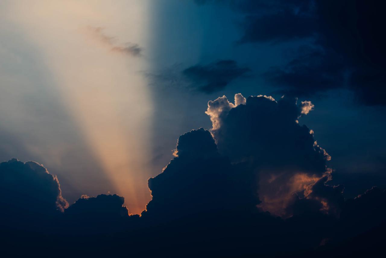 Sunbeam breaking through dark clouds